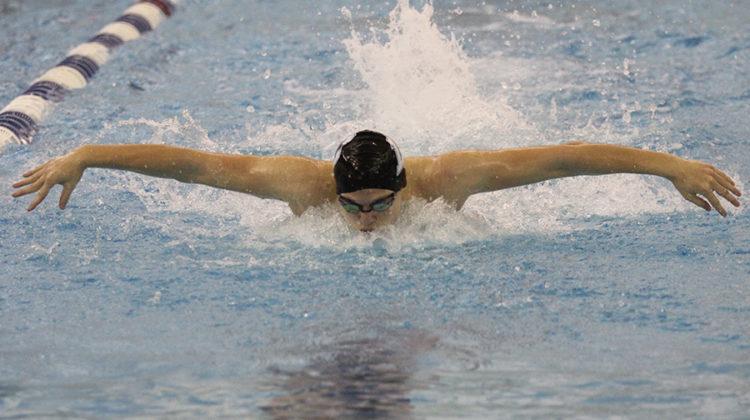 Gavin Baisa (12) is mid-stroke in his 100-meter fly.  This was a close race for Baisa.