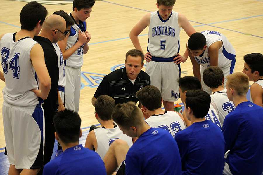 Coach Mr. Stephan Fry talks to the boys during half time. The score at that time was 10-15 with the Lake Central Indians in the lead.