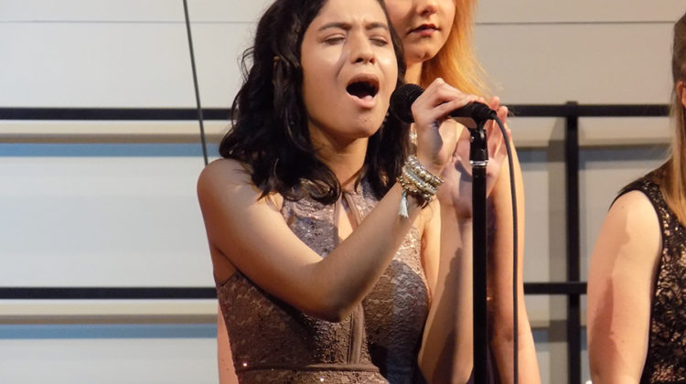"""Estela Madrigal (11) sings a solo. She sang a solo for the song """"All I Want for Christmas is You."""""""