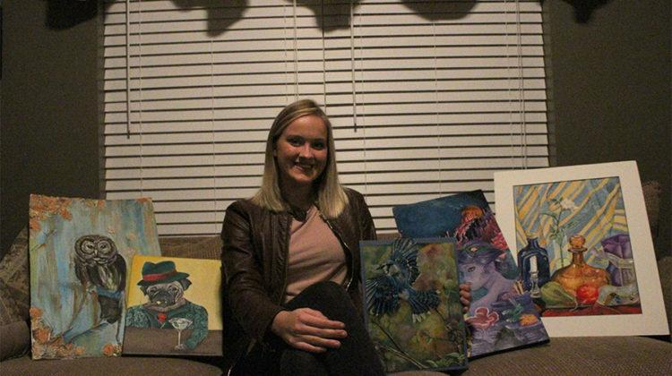 Emily Erikson (12) poses with some of her artwork. Emily has been taking art classes since she was three years old.