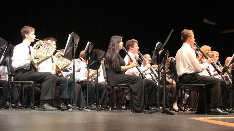 "The Wind Ensemble played three pieces of music. One of their songs was ""Gift of Christmas Music."""