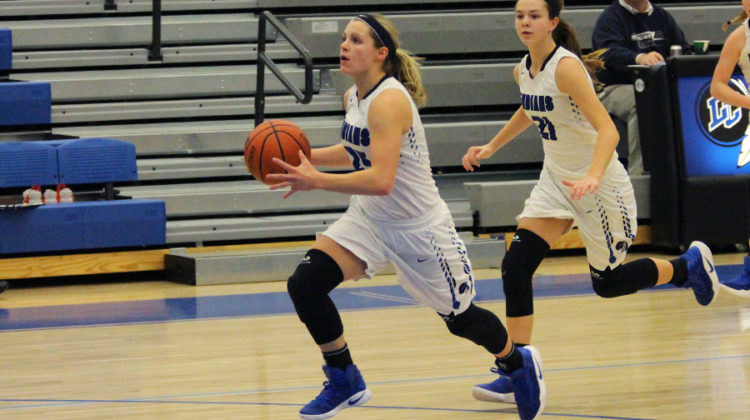 Meghan Long (10) runs down the court with the ball. The girls played Michigan City.