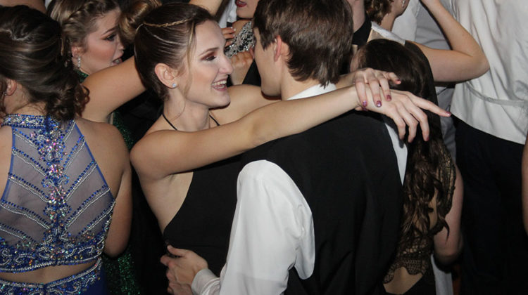 Hayley Skrezyna (11) and Payton Sanders (11) slow dance together. Lake Central's Winter Formal took place on Jan 21.