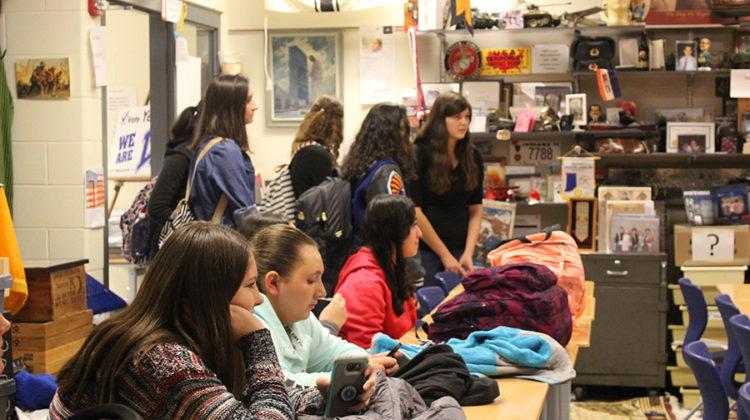 Students spill themselves into the classroom in a rush to find a seat for the movie presentation. Past presentations for history club have included the history of typewriters, election discussions and much more.