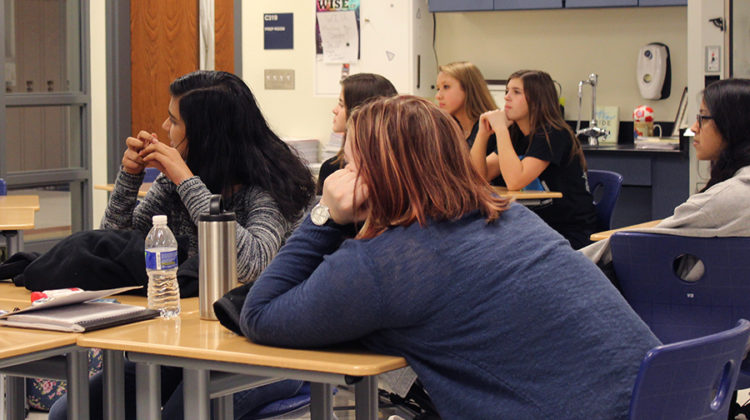 Students listen to the presentation about college decisions. The presentation is part of a lecture circuit of women going into the STEM field or those who are currently a part of it.