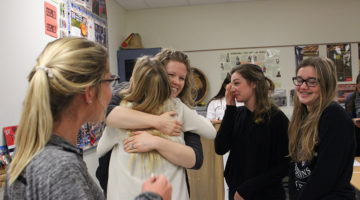 Mrs. Katelin Ellis, Science, wishes her former tennis team the best of luck with hugs. The girls surrounded the teacher and waited to say their goodbyes.
