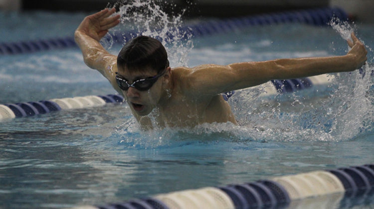 Sam Ruzga (12) competes in the butterfly. This was Ruzga's first year on the swim team.