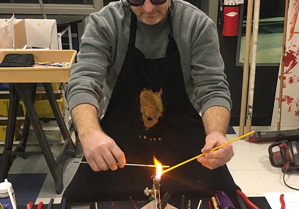Mr. Paul Volk, Art, uses a torch for one of his current art projects. Art projects made by some of his students can be found on his Weebly page, Studio117.