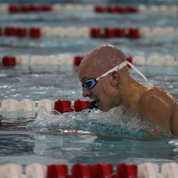 Jack Tinsley (10) swims the 200 IM. The meet took place on Feb. 18.