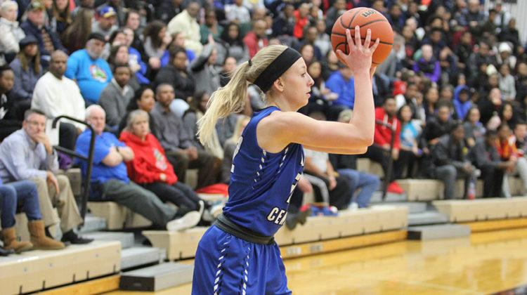 Rachel Robards (11) plays the ball inbound from the sidelines. The score at halftime was 24-23, Lake Central down by one.