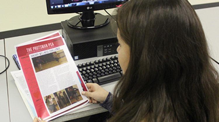 Karisa Candreva (10) reads a newsletter from Protsman. Stefan Krajisnik (12) was assigned to Protsman Elementary for the internship.