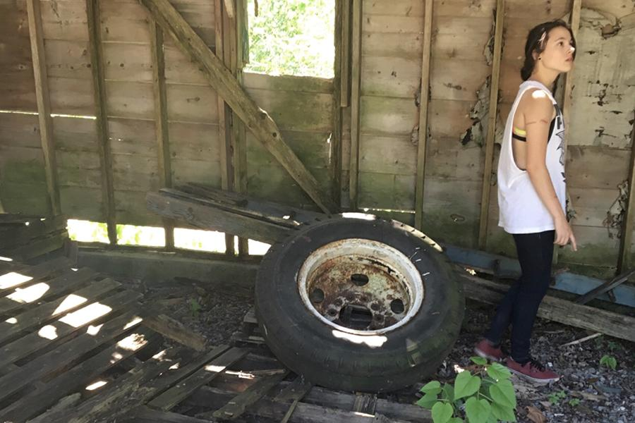 Rebecca Shute (10) is marvelling at the damage and beauty of a shed. She explored an abandoned property last summer.