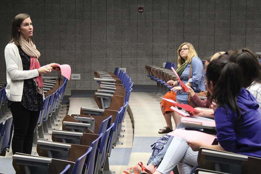 Mrs. Kelsey Becich, English, greets the club in the LGI. The students discussed future plans for N-Teens.