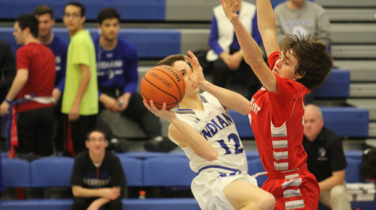 Sam Booth (10) goes inside the lane and shoots. The Indians last loss was February 2nd against Merrillville.