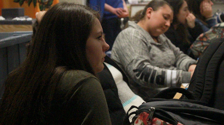 Madeline Spoerner (10) and Mikaila Zvyak (10) listen to a presentation given by Caitlin Mavity (11). Mavity's presentation was about Black History Month.