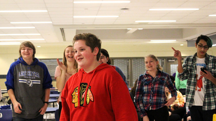 Brandon Slavich (9) stands in the middle of the dancing game. Students dance around him as he tried to guess who started the move.