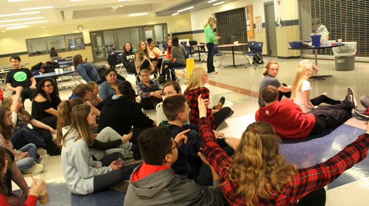 The group chats as they wait for the next activity to start. Campus Life met on Tuesday in the cafeteria.