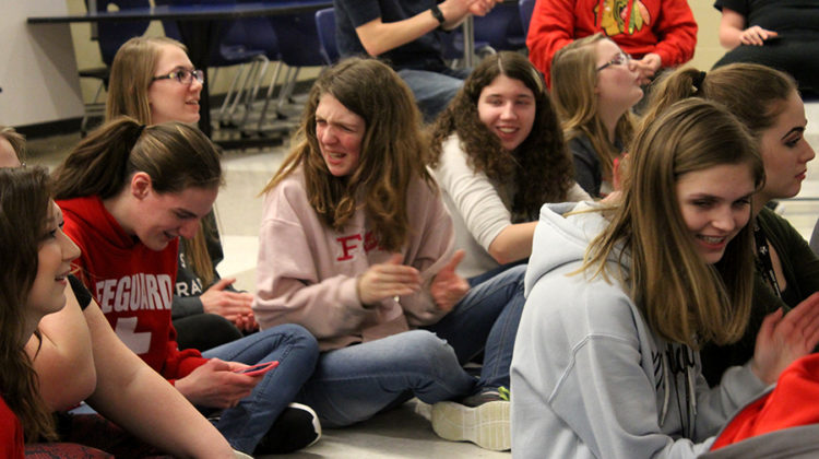 Madison MacLagan (9) and Alyssa Destefano (10) laugh as they clap for the performance. Members were able to form friendships through this club.