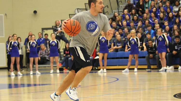 Mr. Andrew Gurnak, Physical Education, runs down the basketball court. Gurnak played in the basketball game between students and staff members.