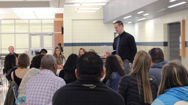 Mr. Todd Smolinski, Social Studies, gives out awards for the girls swim team. After the main ceremony, teams went to separate areas of the school to hand out individual awards to team members.