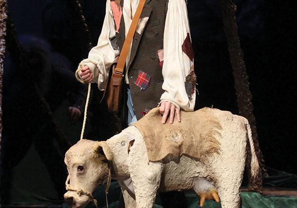 William Kruzan (12) stands on stage with his cow, Milky White, as he travels through the woods. Kruzan played Jack who went into the woods to sell his cow to make money for his family.