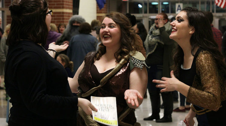 Kaitlyn Vander Laan (12), Anna Samels (12) and Hannah Souronis (12) share a laugh after their senior night performance. All proceeds from Thursday night's show went towards scholarships for Lake Central Theatre Company's seniors.