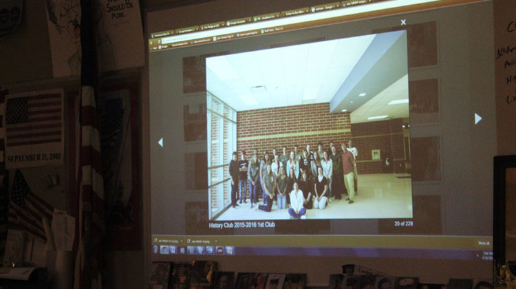 Tom Clark (Social Studies) shows the club last year's club photo. The 2015-2016 school year was the History Club's first year.