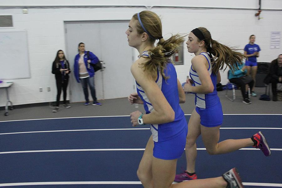 Rachel Kujawa (9) and Lilly Zubeck (9) keep pace together in the mile. Zubeck (second) came in first for the mile and Kujawa (front) came in second.