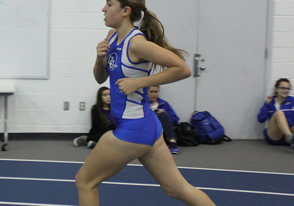 Anna Olivero (9) runs in the 800 and the 4x800 relay. Olivero got a time of 2:53 in her race.