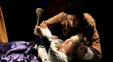 "Halle Pederson (12) performs her dying scene during the theatre company's first performance of ""Into the Woods."" Pederson started acting in middle school when she performed as an orphan in Lake Central's production of 'Annie.'"