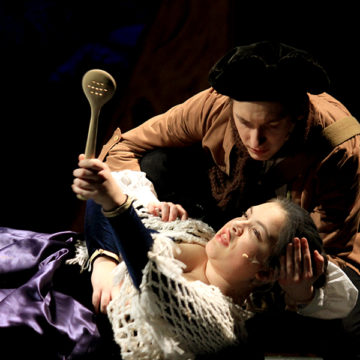 """Halle Pederson (12) performs her dying scene during the theatre company's first performance of """"Into the Woods."""" Pederson started acting in middle school when she performed as an orphan in Lake Central's production of 'Annie.'"""