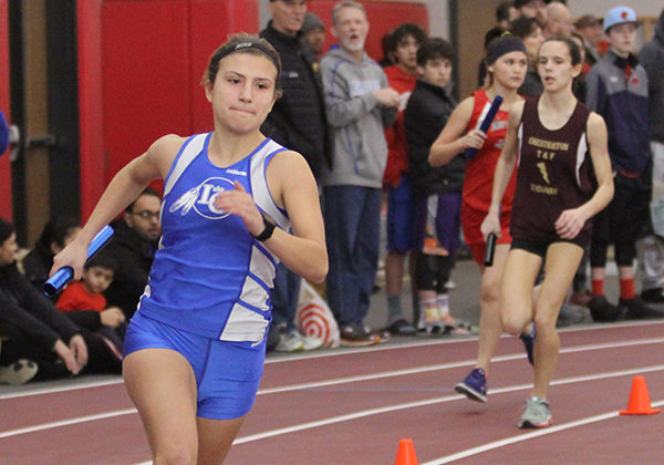 Sarah Hunsley (12) turns the corner at the edge of the class. Hunsley took first in the girls 3200-meter race earlier in the day.
