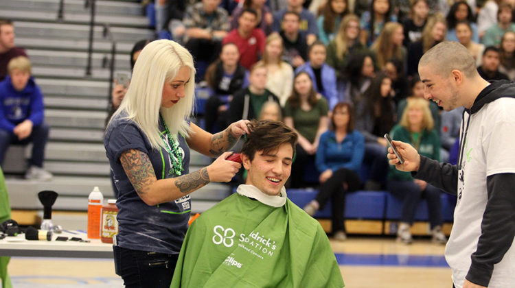 Nicholas Lucas (12) cringes when getting his head shaved. St. Baldricks was first held at Lake Central in 2005.