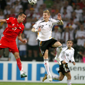 Germany's Bastian Schweinsteiger (7) and Poland's Ireneusz Jelen (21) jump for the ball during the World Cup 2006, Group A game in Stuttgart, Germany, Wednesday, June 14, 2006. (Lionel Hahn/Abaca Press/KRT)