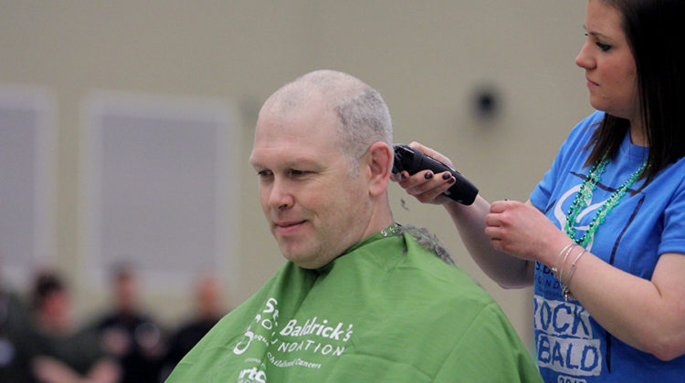 Head Principal Sean Begley gets his head shaved at the St. Baldrick's assembly. Lake Central raised $12,139 for childhood cancer.