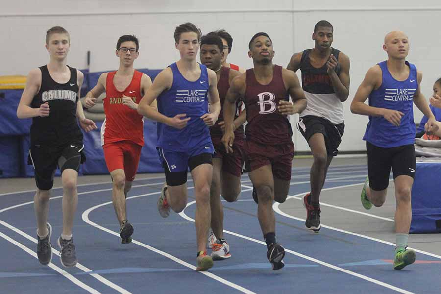 Andrew Ackerman (12) and Issac Beatty (10) lead the pack of runners. Beatty competed in the long jump as well as the mile.