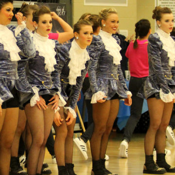 The varsity Centralettes get ready to perform their hip-hop routine at the Lake Central Dance Invitational. The team competed at the national competition.
