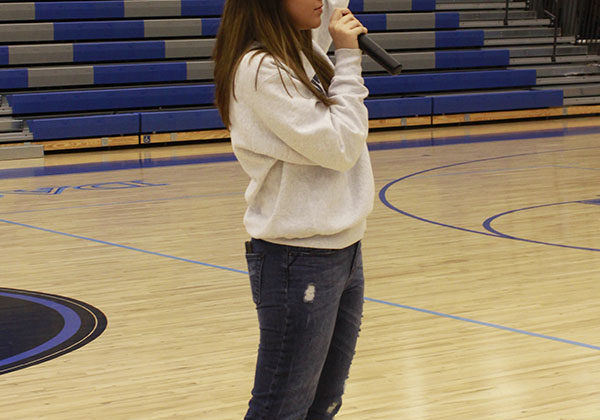 Kaylynn Ward (12) announces the directions. She helped show where each club was to go and give them instructions on what to do.