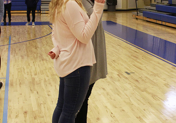 Abigail Hines (12) takes all the club photos. Nicole Milaszewski (12) offered her assistance by counting down for each of the club members to be prepared for their photos.