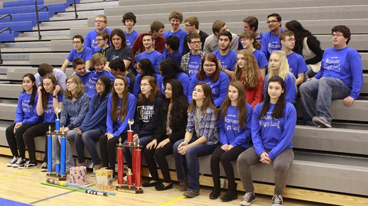 Science Olympiad gathers closely for their picture. The group stayed after to get a less formal picture with their trophies.