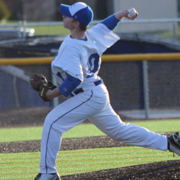Andrew Vanmilligan (11) pitches in a varsity game last summer.  He pitched only one varsity game last year because of his hurt arm.