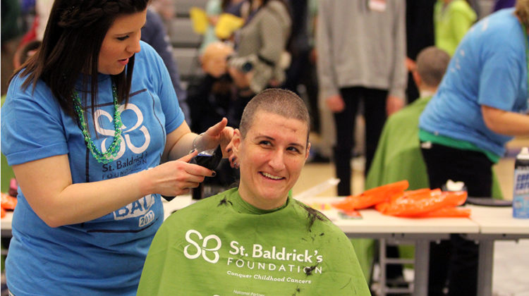 Ms. Carrie Wadycki, Arts, gets her head shaved at the St. Baldrick's assembly. Ms. Wadycki decided last minute to become a shavee.
