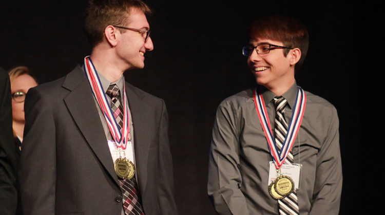 Zack Seliger (11) smiles at Preston Petrie (12) during the open events award category. Seliger placed second, and Petrie placed first.