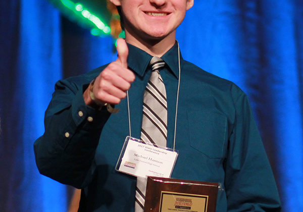 Michael Harmon (11) gives a thumbs up after placing fifth in Fundamental Word Processing. Even though it was his first year in BPA, Harmon qualified for Nationals.