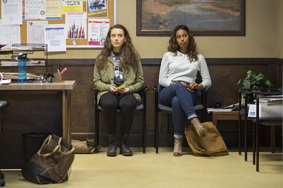 "Hannah Baker, played by Katherine Langford, and Jessica Davis, played by Alisha Boe, sit in the office waiting to speak to the counselor in the show ""13 Reasons Why."" The first season contained 13 episodes. (Beth Dubber/Netflix)"