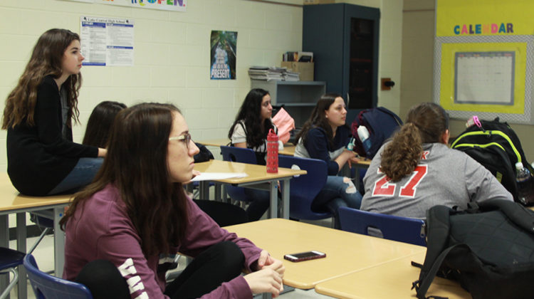 Members of sophomore class cabinet listen to new ideas about t-shirts. They shared thoughts on the best designs.