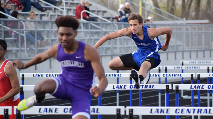 Caleb Pisowicz (11) competes during a hurdle event during a track meet at home. This was Pisowicz's first year competing in varsity hurdle events.