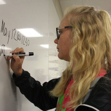 Rachel Frieling (12) writes the details for race day on the white board. Frieling was in Student Council for two years and was the president this year.