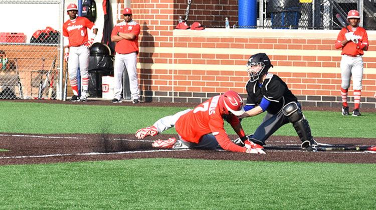 Jarrett Lopez (12) makes an out at home in the fifth inning. The out allowed no runs for Homewood-Flossmoor in the 3-0 win for Lake Central.