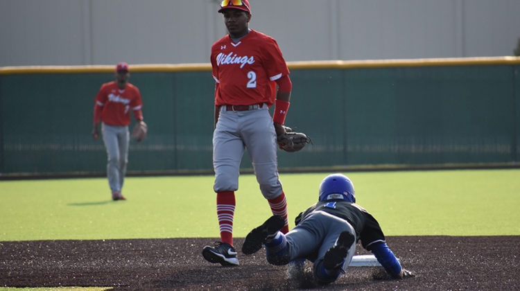 Nicholas Bandura (12) slides into second base after a RBI double in the fifth inning. Bandura has played shortstop in place of Conner Tomasic (11), who is out for the season with an injury.